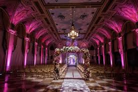 wedding arches inside colorful ceremony ballroom reception at the breakers