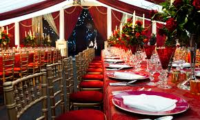 vibrant red floral table decorations created for a russian themed