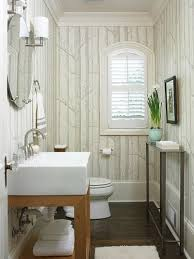 Neutral Color Bathrooms - bold patterned wallpaper adds fun texture to this nature ins