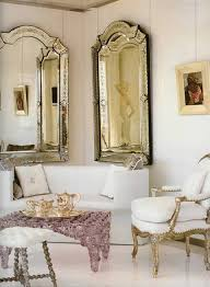 living room with gilded french side chairs and ornate vintage