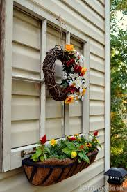 vintage window turned outdoor decor and flower planter sprucing
