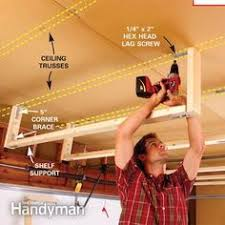 How To Build Garage Storage Shelving by 11 Easy Garage Space Saving Ideas Garage Ideas Ceilings And Storage