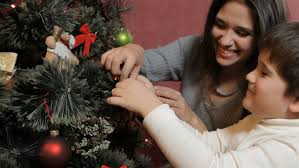 Mother Daughter Christmas Ornaments Attractive Mother Helping Her Daughter To Hang The Bauble On The