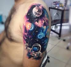 astronaut holding planet balloons best tattoo design ideas
