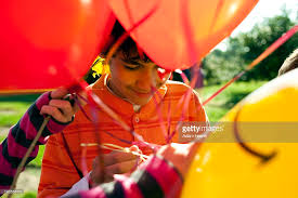 balloons for him boy with balloons around him stock photo getty images