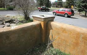 straw bale wall blocks sound bend couple creates garden wall with