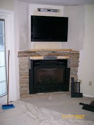 remote controlled gas fireplace in corner with cultured stone