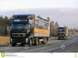 volvo heavy duty trucks two black volvo trucks haul mobil delvac oils editorial