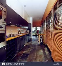 modern galley kitchen photos slate floor and wooden venetian blinds in modern galley kitchen