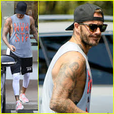 david beckham u0027s wife victoria shows off his new neck tattoos