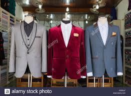 men u0027s suit on mannequin in front of dress room stock photo