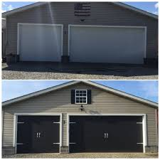 before and after garage doors painted the garage doors black