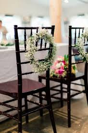 mahogany chiavari chair baby s breath wreath on mahogany chiavari chair