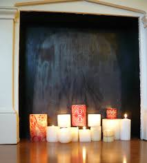 exciting white candles in fireplace photo design inspiration tikspor