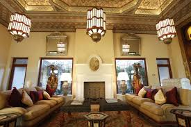 living room with double sofas and hanging moroccan lights also