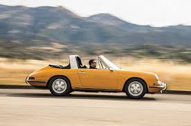 orange porsche 911 convertible then vs now 1967 porsche 911s targa vs 2016 porsche 911 targa 4s