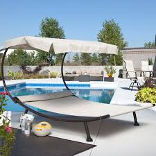 exterior black iron arc canopy daybed with double chaise lounge