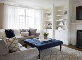 blue and gray living room elegant living room features traditional fireplace under