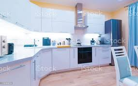 blue kitchen cabinets and yellow walls interior kitchen modern light yellow walls blue curtains stock photo image now