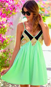 green mini dress with sequins detailing for summer fashion