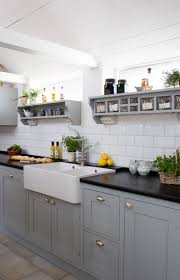 white and grey kitchen black quartz countertop subway tile backsplash white apron front