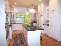 crown molding brown granite countertops u shaped kitchen light