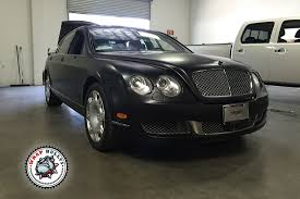 bentley wrapped bentley continental flying spur satin black car wrap wrap bullys