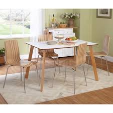 Cleaning A Wooden Dining Table by A White Dining Set Has Wood Elements Which Adds Interest While