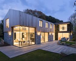 modern family house a new home of stone and wood arrives on the island of guernsey