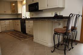 Omega Kitchen Cabinets Prices Angled Corner Filler On End Of Peninsula And Decorative Door