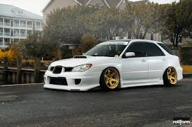subaru station wagon subaru wrx station wagon sporting gold custom painted rims by