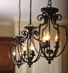 three wrought iron hanging pendant light fixtures handler