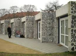rustic shipping container stone facade container house