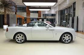 rolls royce white convertible do you find this rolls royce dawn fashionable