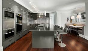 modern dark gray kitchen cabinets white marble countertop double