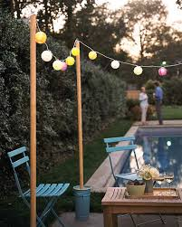 garden glow gardens light string and wooden poles