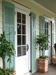 found my dream house light gray shingles and aqua doors and