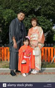 a japanese family wearing traditional kimono clothes prepare for