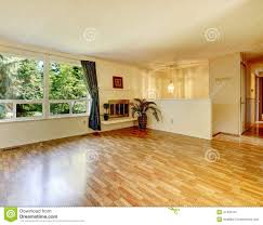 empty living room with fireplace and shiny hardwood floor stock