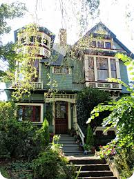 queen anne victorian beautiful green queen anne victorian house with turret a photo