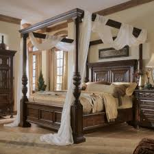 White Metal Canopy Bed by Brown Stained Wooden Canopy Bed With Carved Rectangle Geadboard