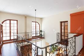 Banister International Classy House Mezzanine With An Elegant Metal Banister Stock
