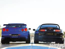 cars toyota black 1994 toyota supra tt and 2000 nissan skyline gt r black and blue