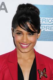 pic of black women side swept bangs and bun hairstyle freida pinto cute black loose bun updo with side swept bangs