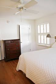 classy white bedroom design ideas with white four blade fan