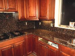 brown granite countertops with white cabinets dark brown cabinets with granite countertops backsplash for white