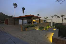 open carport open garage and carport covered with stone floors greenery and