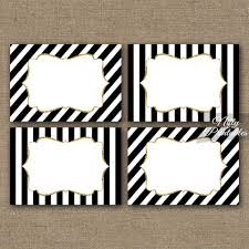 black and white striped food labels or nametags with a gold