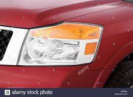 red nissan 2008 2008 nissan armada le in red headlight stock photo royalty free