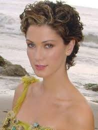 short curly permed hairstyles for women over 50 short curly haircut for women over 50 lively curls in razored cut